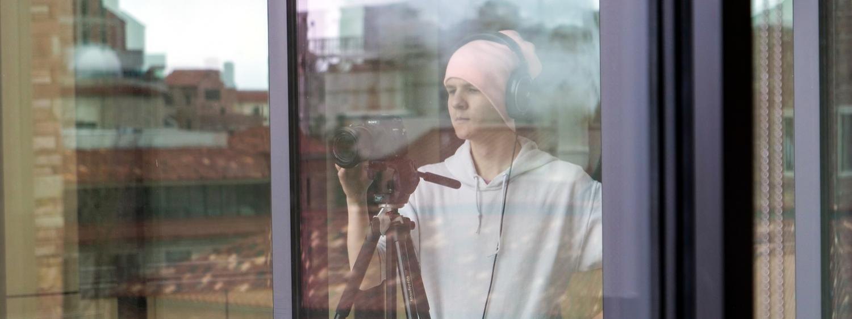 Nick Mundinger through the window of CASE
