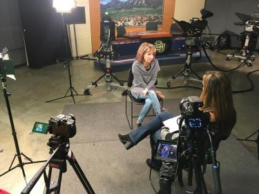 9News anchor Kim Christiansen (Jour'84) speaks with Media Production student Natalie Wadas about her time at CU Boulder and her subsequent career at 9News.