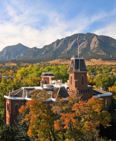 Old Main on the CU campus, with the Flatirons in the distance.