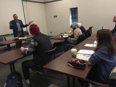 NBC News correspondent Tom Costello (Jour'87) teaches CMCI students to write memorable broadcast scripts using materials from real NBC News stories.