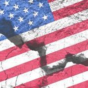 Cracked sidewalk with flag