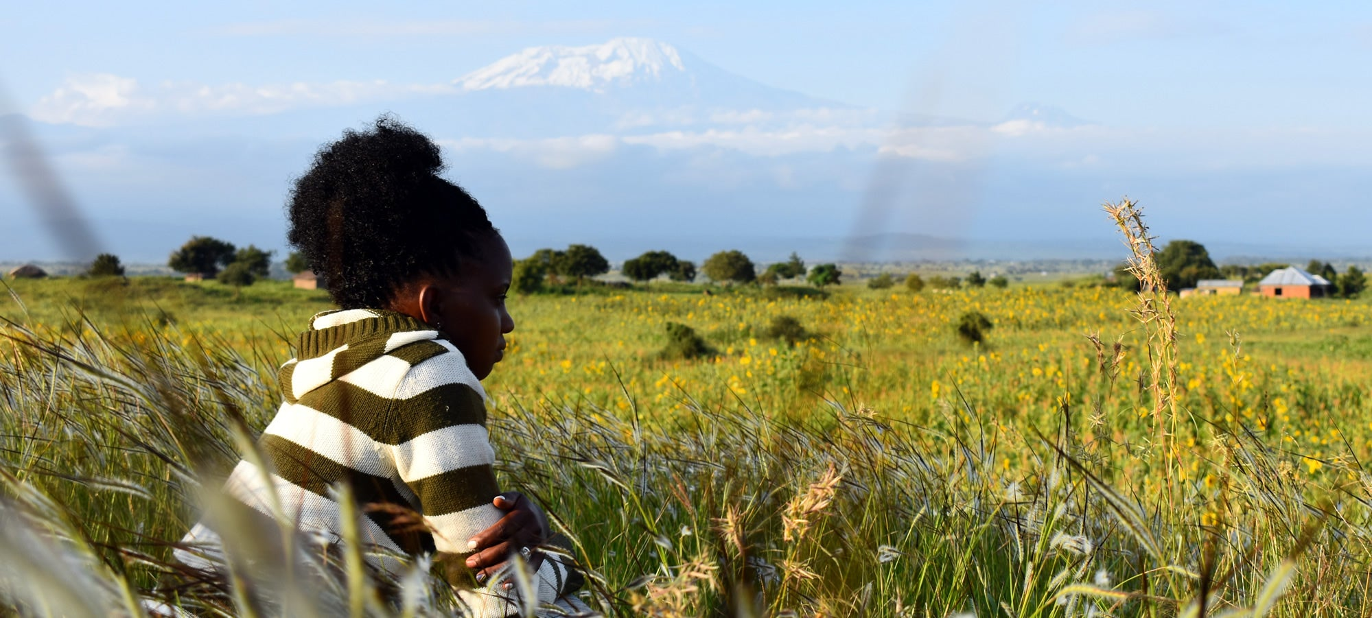 Image of Mollel taken in 2018, showing the close proximity of her village to Mount Kilimanjaro.
