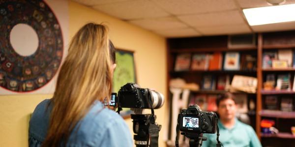 Tessa Diestel interviews Tim Gamwell, director of the Guatemalan-Maya Center in West Palm Beach, Florida. Photo by Angel Mendoza.