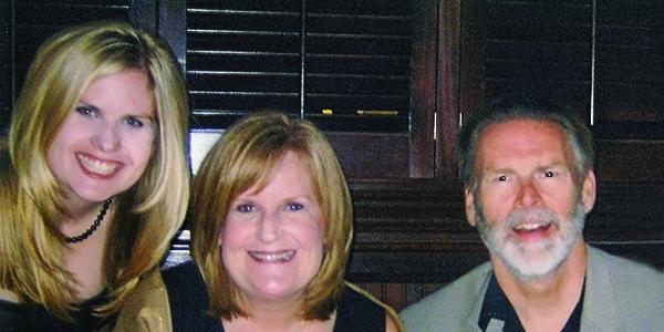 Left to right: Megan McCarty Johnson (Comm'02), Julie Moriarty McCarty (Comm'74)  and John Thomas McCarty Jr. (Comm'74)