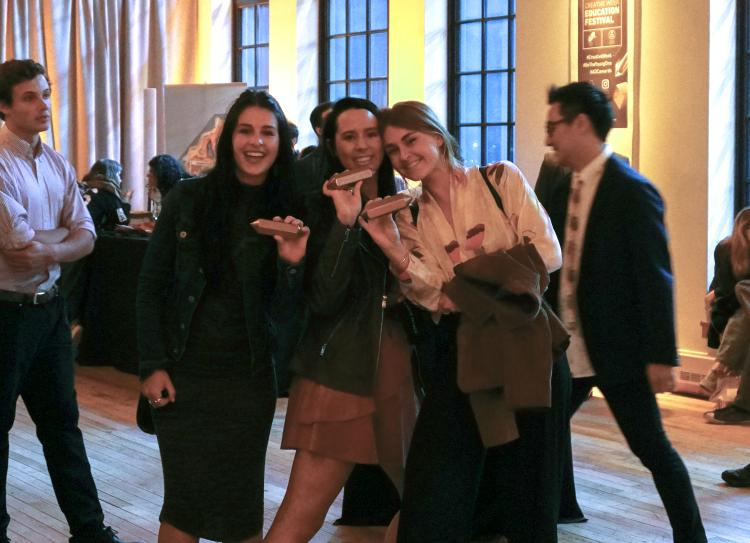CU students triumphantly hold their Pencil awards
