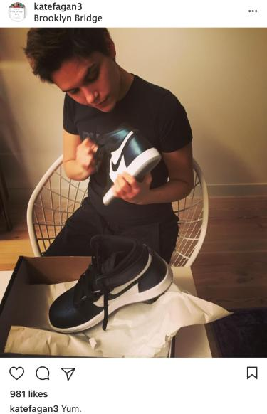 Fagan examines new shoes. Photo is from her Instagram account.