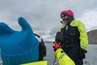 Former CMCI graduate student Kat Canada records an interview about climate change with Kim Holmén, International Director of the Norwegian Polar Institute.