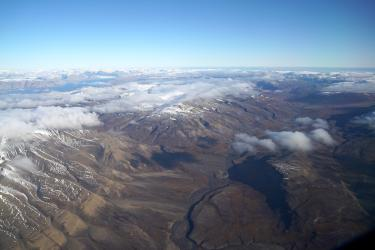 An aerial view over the treeless landscape of Svalbard.