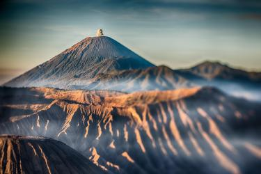 Java's massive Tengger volcanic complex–a tight grouping of five active volcanoes–one of which has over 50 documented eruptions.