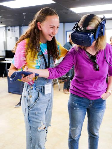 A student and mother check out virtual reality in CMCI's Immersive Media Lab