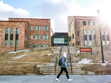 A student walks by the CASE building, home of CMCI's administrative offices, podcast booths, advertising studio and more.