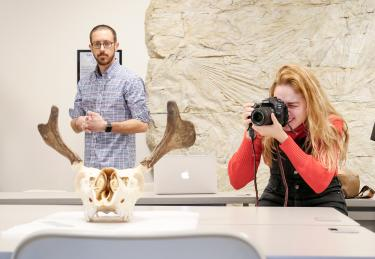 Student taking photo of a fossil.