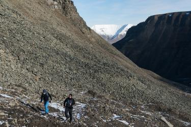 Norwegian students participating in the Arctic Lenses project climb steadily during the glacier hike above Longyearbyen.