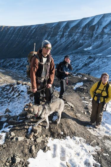 A Norwegian student and Kat Canada of CMCI pause with one of the guides during the climb up to the glacier.