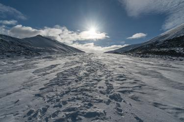 The sun scoots low over a snow-covered portion of Longyearbreen, a glacier near Longyearbyen. Two months after this photo was taken in September, polar darkness descended on Svalbard – as it does every year in mid-November. The sun would not return until March.