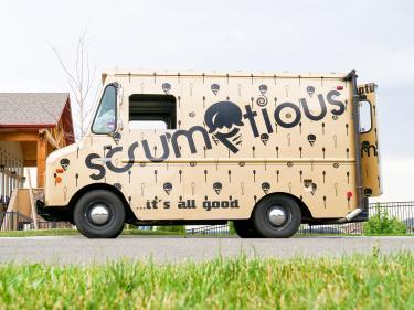 Scrumptious ice cream truck parked in neighborhood.