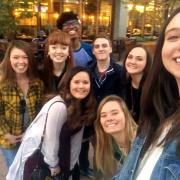 Students pose for a selfie after attending a theatre outing with Willis.