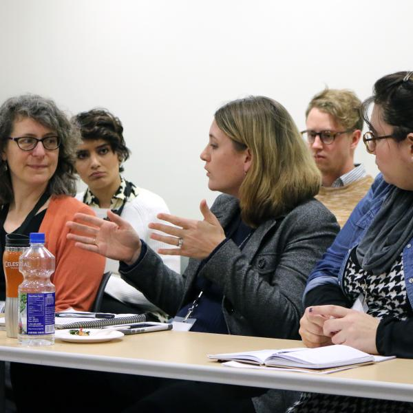 A panel of presenters discuss their papers