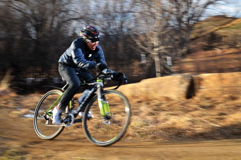 Allen Lim riding his bike on a trail
