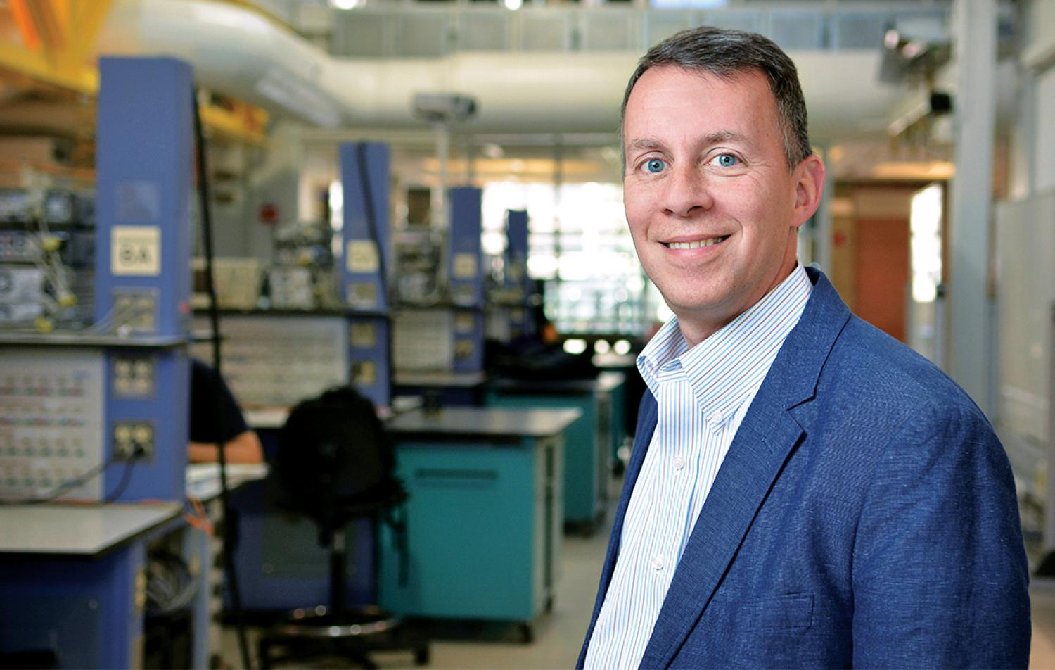 Bobby Braun poses for a photograph in his lab