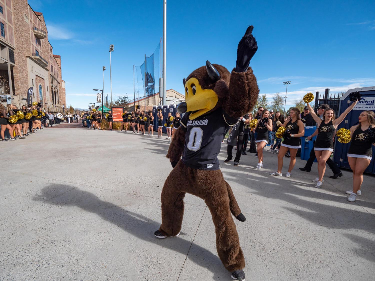 Chip dances outside Folsom Field at a Homecoming pregame.