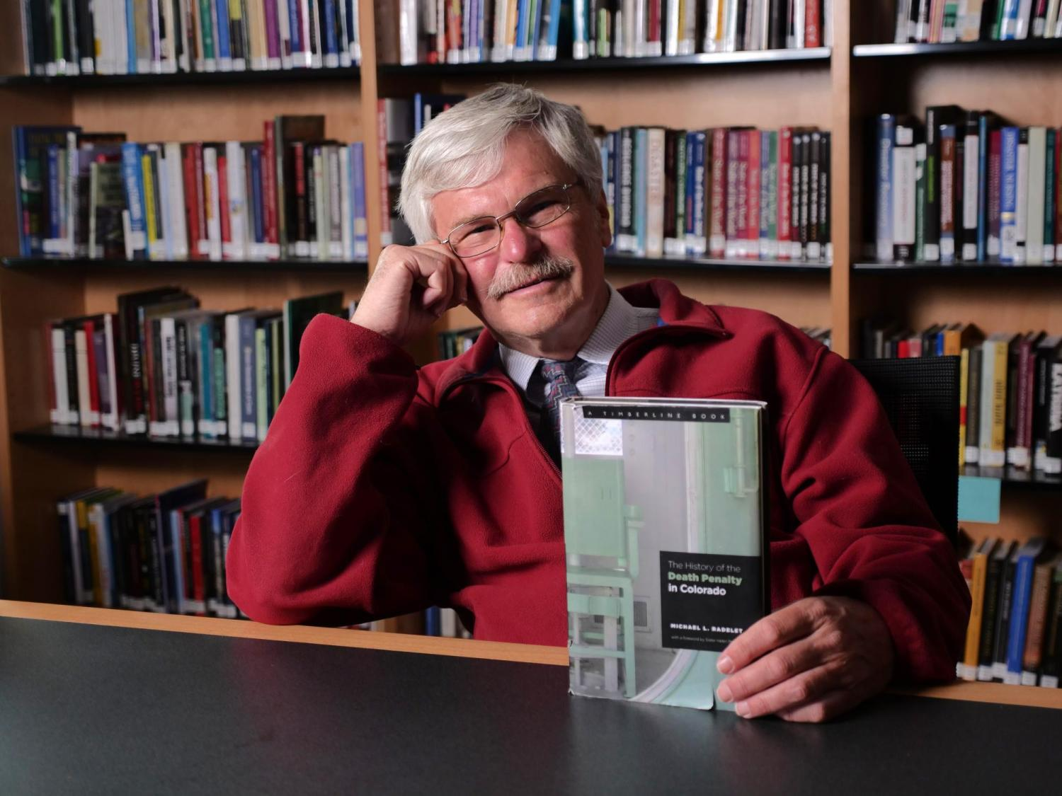 """Michael Radelet with book titled """"Death Penalty in Colorado"""""""
