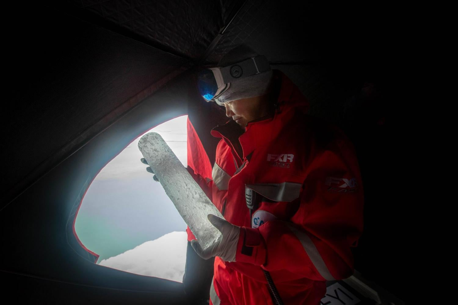 researcher analyzing an ice core