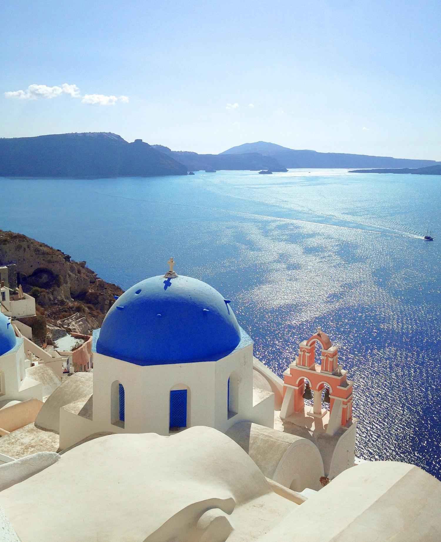 Image of building roof and Aegean Sea in Greece