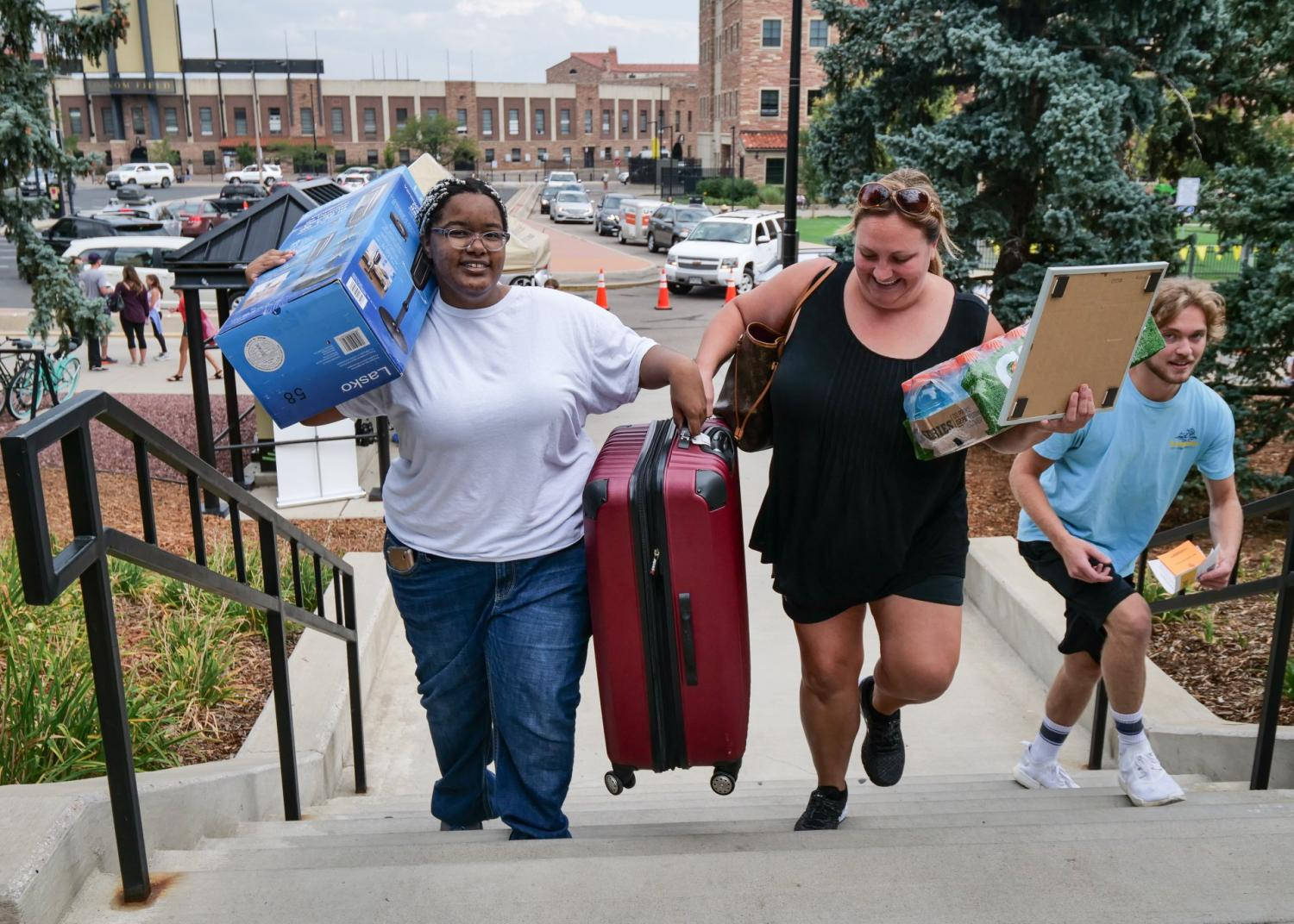 Students move into their dorms with the help of volunteers