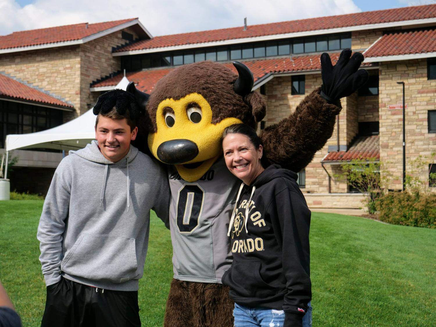 Mother and daughter pose with CU's mascot