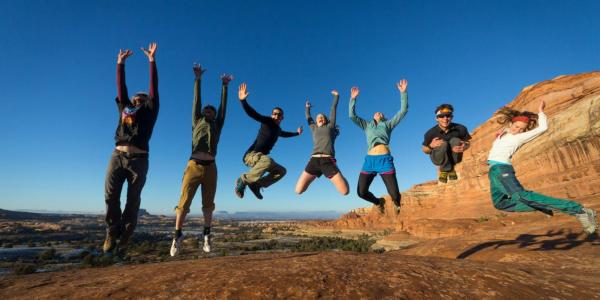 Members of the CU Hiking Club jump for joy