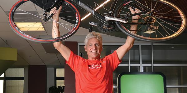Dan King holding a bike