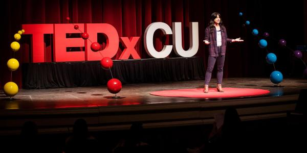 Nina Williams rehearses her presentation on the TEDxCU stage.