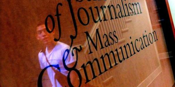 journalism school sign