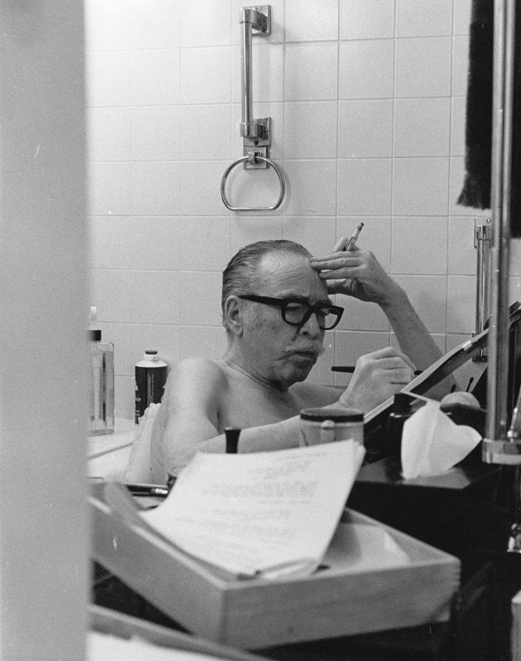 Dalton Trumbo working in his bathtub