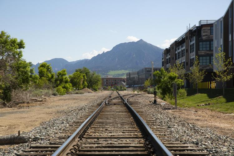 Train track with Flatirons in background
