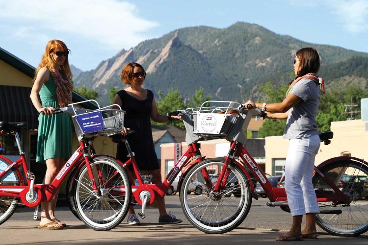 Women testing out their B-Cycle bikes