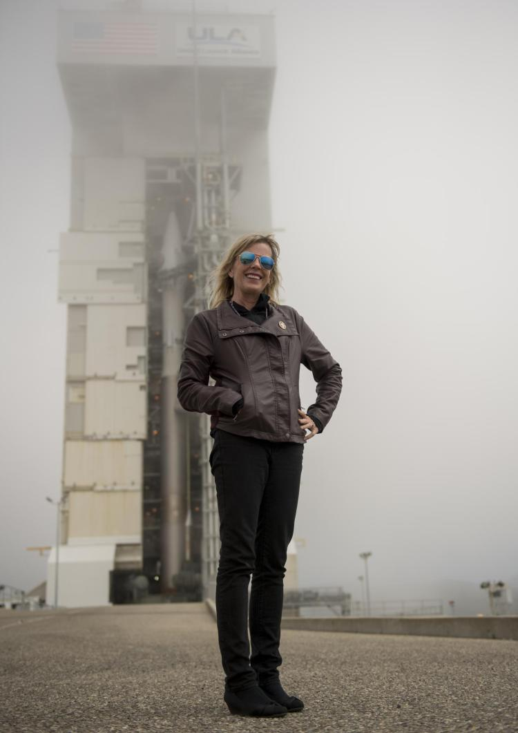 Laurie Cantillo in front of a rocket at NASA