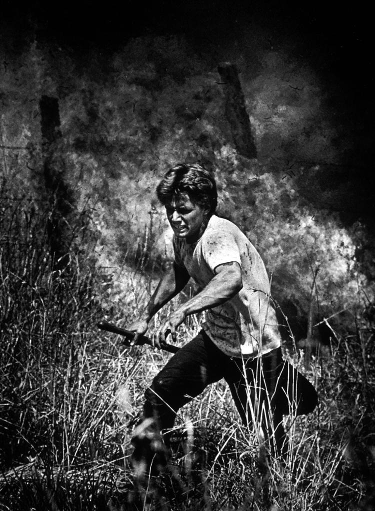 prisoner running from fire
