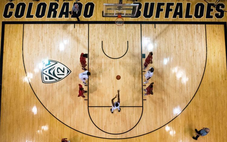 An image taken from above while a CU men's basketball player shoots a free throw on the court at the CU Events Center.