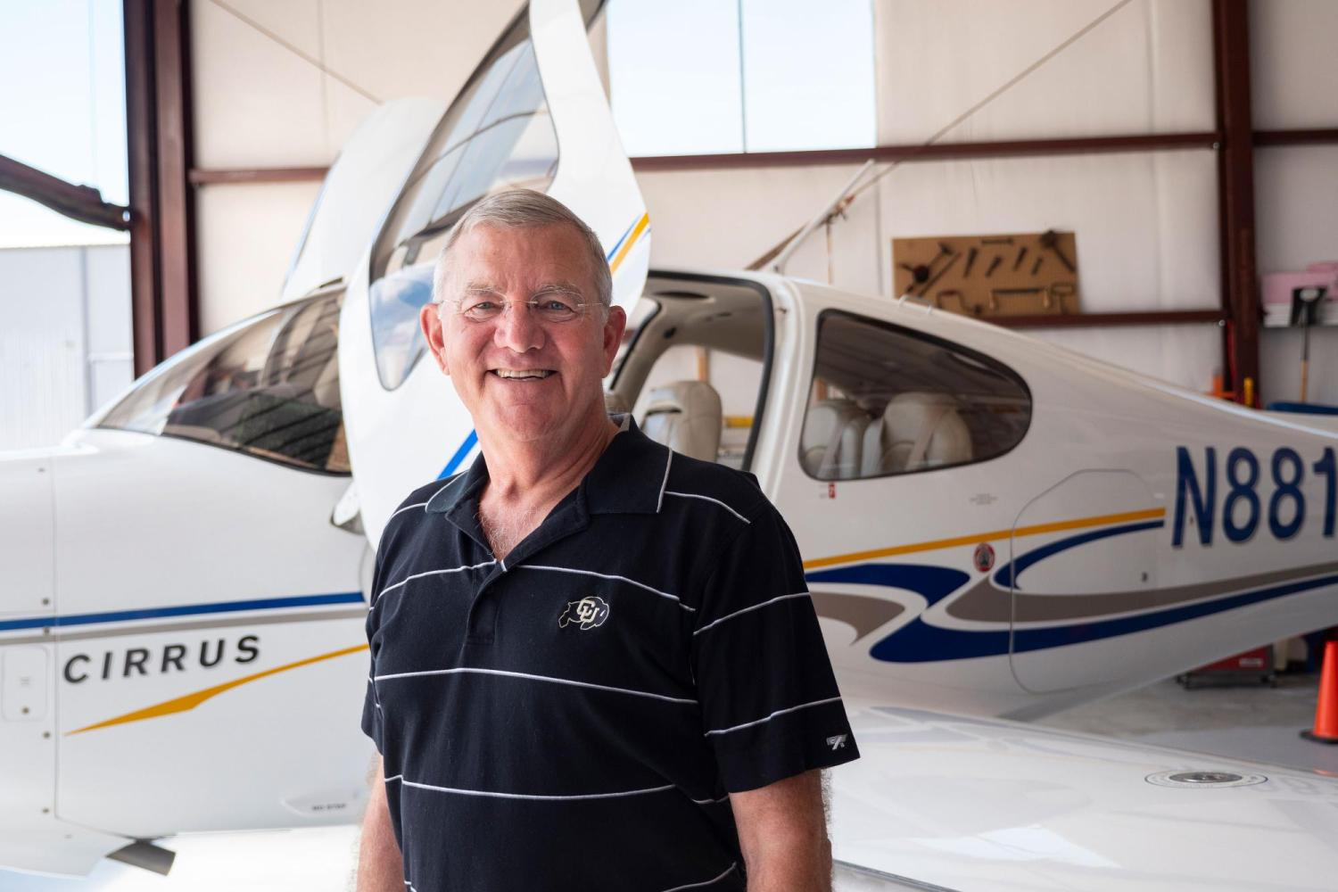 Portrait of Jim Voss in front of his airplanes