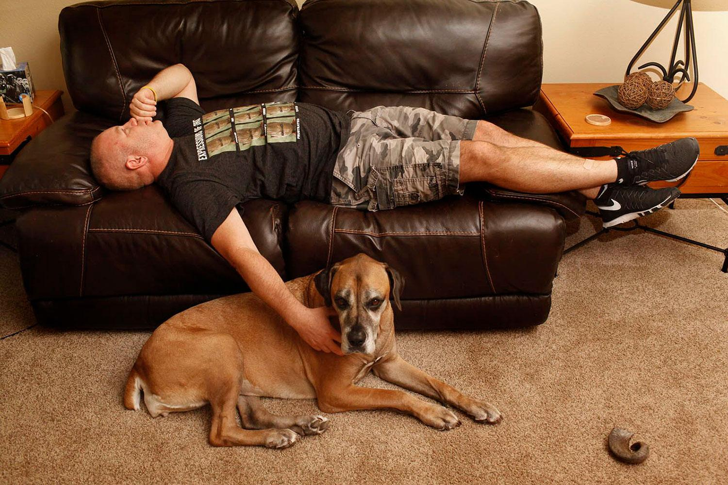 Man grieving on couch