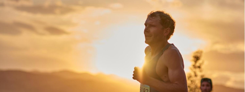 Jake Riley runs while the sun sets.