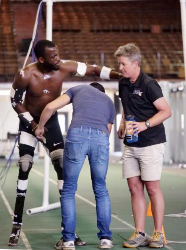 Alena and her team assist Blake Leeper adjust his prothetics