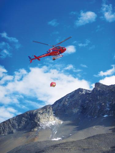 Helicopter dropping of researchers in Antarctica