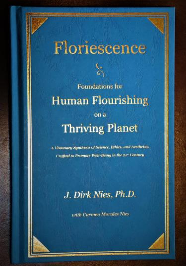 Floriescence cover; blue with gold lettering