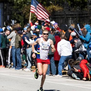 Jake Riley runs in a race.