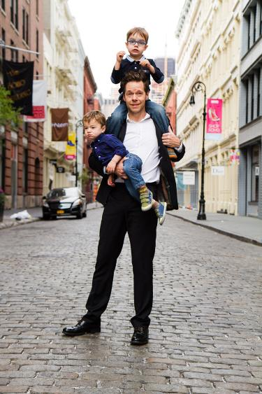 Gavin with kids on shoulders