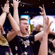 Ted Chalfen cheering on the Buffs with the C-Unit student section.