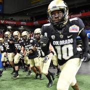 CU buffs football players run onto the field